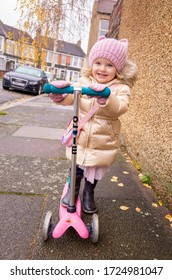 LONDON - DECEMBER 13, 2016: Two year old child on her Mini Micro Scooter