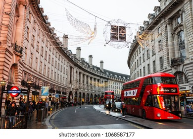 LONDON - DECEMBER 20, 2017: The characteristic curve of buildings on Regent Street in central London on a cloudy Winter day, UK.