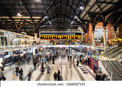 LONDON - DECEMBER 20, 2017: Main hall of Liverpool Street Station in Central London, full of travellers and commuters. Long exposure.