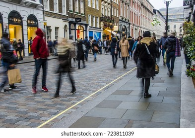 LONDON- DECEMBER, 2016:  Crowds of high street shoppers in Covent Garden, London around Christmas time.