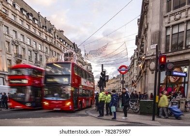 LONDON- DECEMBER, 2017: Busy Oxford Road shopping scene in with crowds of people and iconic red buses