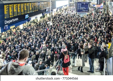 LONDON- DECEMBER, 2017: A very crowded train station concourse inside London Waterloo Station at rush hour