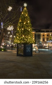 LONDON - DECEMBER 21st 2014: Christmas tree and lights decorations on Duke of York Square offers a range of international retailers and leading restaurant alongside the iconic Saatchi Gallery.