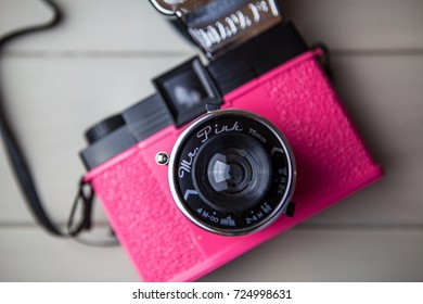 LONDON - DECEMBER 22, 2014: A bright pink Lomography film camera with flash