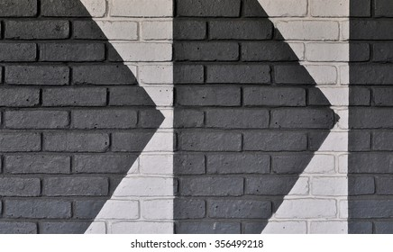 LONDON - DECEMBER 23, 2015. Painted directional arrows on a brick wall at the Broadway Shopping Centre in the Borough of Hammersmith and Fulham, west London, UK.