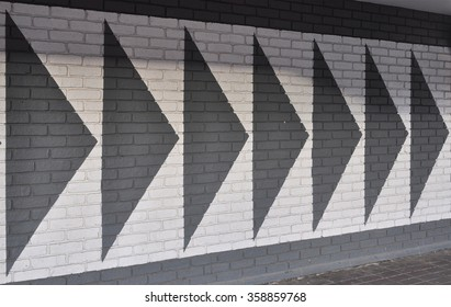 LONDON - DECEMBER 23, 2015. Painted graphics on a brick wall at the Broadway Shopping Centre in the Borough of Hammersmith and Fulham, west London, UK.