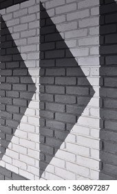 LONDON - DECEMBER 23, 2015. Painted arrows on a brick wall at the Broadway Shopping Centre in the Borough of Hammersmith and Fulham, west London, UK.