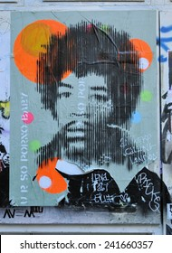 LONDON - DECEMBER 28. Poster of Jimi Hendrix in a yard just off Brick Lane at Shoreditch in the Borough of Tower Hamlets on December 28, 2014, an area renown for its street art in east London, UK.