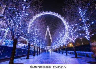LONDON – DECEMBER 7, 2014: Night shot of the London Eye with colorful of purple tone, The 135 meter landmark is a giant Ferris wheel situated on the banks of the River Thames in London, England.