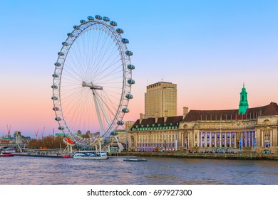 LONDON – DECEMBER 7, 2014:  Twilight View of the London Eye on the South Bank of the River Thames. Also known as the Millennium Wheel, when erected in 1999 it was the world's tallest Ferris wheel.