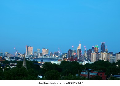 London at dusk viewed from Primrose Hill, United Kingdom, in a misty day