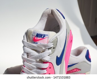 london, englabnd, 05/08/2018 Nike Air max 90s, White, pink, purple, Nike air max retro classic sneaker trainers. Nike sport and street wear fashionable athletic apparel. Isolated nikes.
