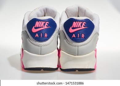 london, englabnd, 05/08/2018 Nike Air max 90s logo, White, pink, purple, Nike air max retro classic sneaker trainers. Nike sport and street wear fashionable athletic apparel.