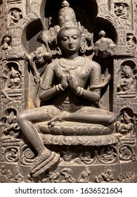 London. England. 01.24.2020. The Bodhisattva Avalokiteshvara seated on Mt. Potala (circa 1000AD) in the Victoria and Albert Museum in central London in the United Kingdom.
