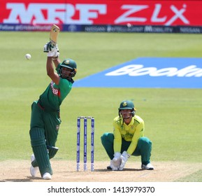 LONDON, ENGLAND. 02 JUNE 2019: Shakib Al Hasan of Bangladesh plays a shot as wicketkeeper Quinton de Kock of South Africa looks on during the South Africa v Bangladesh, ICC Cricket World Cup match
