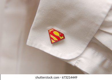 london, england, 02/02/2016, superman superhero marvel cuff links in a decorative box on a white silk background. Unusual mens wedding detail.