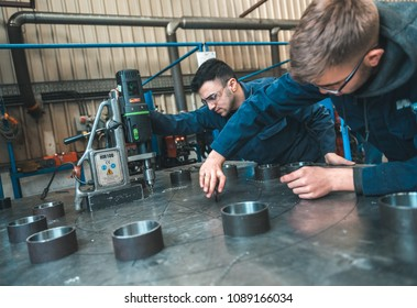 london, england, 02/02/2018, Young industrial metal working apprentice workers learning various metal working skills in an industrial factory setting. Apprentice schemes returning to england.