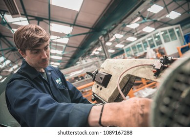 london, england, 02/02/2018, Young industrial metal working apprentice worker learning various metal working skills in an industrial factory setting. Apprentice schemes returning to england.