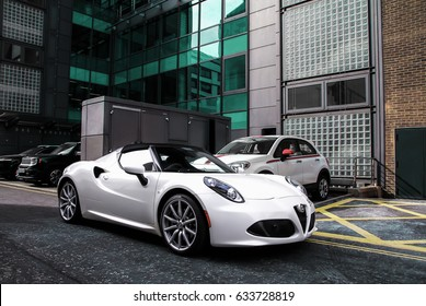 London, England - 02.05.17: an Alfa Romeo 4C Spider sport car is parked in Mayfair. All sorts of expensive and interesting cars can be seen in London, as summer approaches and there is nice weather.