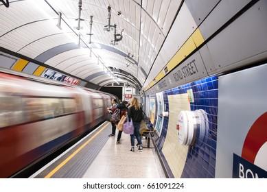 London, England. 04 march, 2016. London underground. Train coming to Bond street station. Waiting passengers.