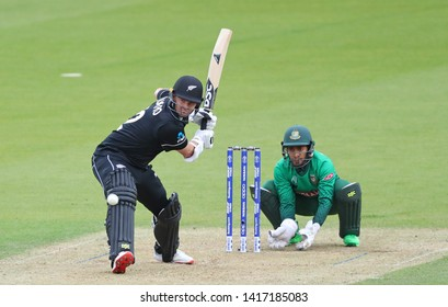 LONDON, ENGLAND. 05 JUNE 2019: Colin Munro of New Zealand batting as wicketkeeper Mushfiqur Rahim of Bangladesh looks on during the Bangladesh v New Zealand, ICC Cricket World Cup match