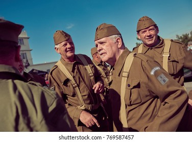 london, England, 05/05/2017, A stylish retro vintage fashionable group of world war two ww2 war veterans in soldier fancy dress. Best dressed award at a vintage nostalgic 1940's event.