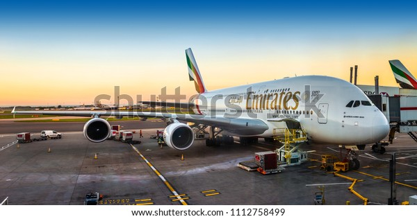London, England - 05.05.2018: An Emirates Airbus A380-800 super jumbo, the largest passenger aircraft in the world is waiting for passengers and loading at London Heathrow terminal 3 during sunset