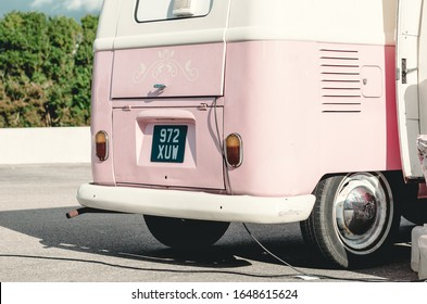 london, england, 05/05/2019 A beautiful well looked after pink VW volkswagen camper van parked up in a car park. collectors vintage vehicle for camping and surfing holidays. summertime fun.
