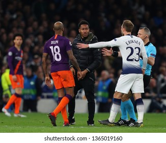LONDON, ENGLAND: 09 MAR 2019. A pitch invader is confronted by Fabian Delph of Man City during the UEFA Champions League Quarter Final, First Leg match
