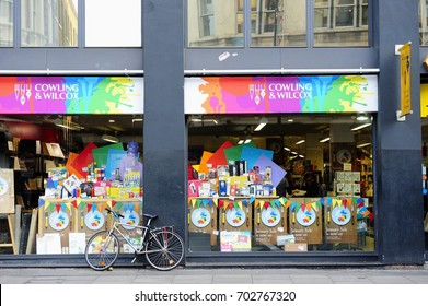 LONDON, ENGLAND- 10 JANUARY 2015: A bike leans against the wall of the art shop in Shoreditch High Street. Shoreditch is an inner city district in the historic East End of London, England, UK