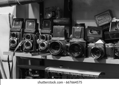 london, england, 10/05//2017 An old bronica, kiev, yashica and pentax retro vintage film photography camera collection, on a shelf in an old antique shop.
