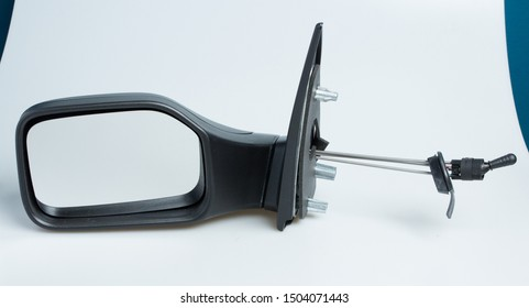 London, England, 10/09/2019 Peugeot 106 1998 left near side wing mirror for cars. Shot on isolated white background with smooth gradient. Car part with adjustable cable, aerodynamics designed in 90's