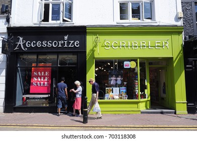 LONDON, ENGLAND- 11 JULY 2013: Undefined people walking in front of the Colorful shops in the shopping center of Kingston upon Thames, also known as Kingston, is an area of south west London, England