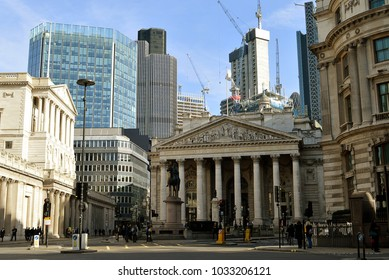 LONDON. ENGLAND - 12 FEBRUARY 2018: The Bank of England and the Royal Exchange, the City of London's historic banking and trading heart are dwarfed by new developments behind.