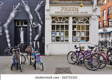 LONDON, ENGLAND -12 MARCH 2015- Editorial: Painted walls and graffiti art are scattered in the Brick Lane street area in East London in the heart of Banglatown.