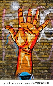 LONDON, ENGLAND -12 MARCH 2015- Editorial: Painted walls and graffiti art are scattered in the Brick Lane area in East London in the heart of Banglatown.