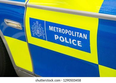 London, England- 12th January 2019- Metropolitan Police sign on side of police patrol car door.