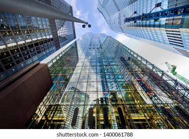 """London, England: 13 May 2019:  Skycraper in the """"City"""" of London one of the leading centres of global finance in prospective from below."""