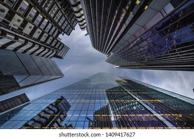 """London, England: 13 May 2019:  Skycrapers in the """"City"""" of London one of the leading centres of global finance in prospective from below."""