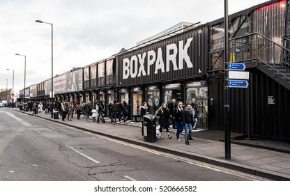 London, England - 13 November 2016: People walking at the BOXPARK, a cool pop up shopping venue with several indie shops and bars in Shoreditch, London, UK.