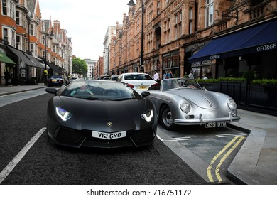 London, England - 17.06.17: Lamborghini Aventador Roadster and Porsche 356A on a street in Mayfair area of central London. There is a modern supercar on this photo, and a classic one from 1950s.