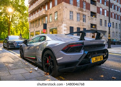 London, England - 17.06.18: Lamborghini Huracan Spyder parked in Knightsbridge district. Supercars like this Lamborghini is a common sight in wealthy neighborhoods of London.