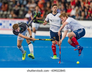 LONDON, ENGLAND - 17th JUNE, 2016: Ashley Jackson of GBR (R) and Martin Haner (L) of DEU in action during the Hockey Champions Trophy Mens Final, GBR vs DEU Queen Elizabeth Olympic Park London.