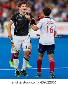 LONDON, ENGLAND - 17th JUNE, 2016: Adam Dixon of GBR and Timm Herzbruch of Germany are talking at Hockey Champions Trophy Mens Final, Great Britain vs Germany at Queen Elizabeth Olympic Park London.