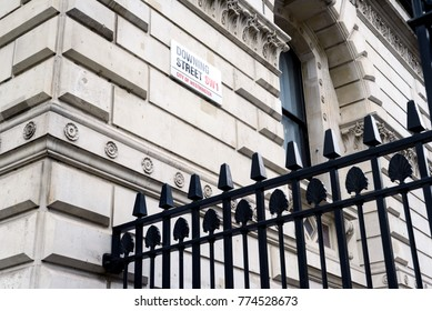 LONDON, ENGLAND 1ST NOVEMBER 2017 - Famous 10 Downing Street SW1 City of Westminster sign on a wall with a black security fence in the foreground