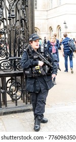 LONDON, ENGLAND 1ST NOVEMBER 2017 - Armed policewoman with sub-machine gun and taser stands guard in England London