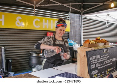 London, England - 2 April, 2107: Stall at Maltby Street market, Rope walk, in SE1 London. A popular weekend market with artisan food stalls and quirky bars and restaurants in the railway arches.