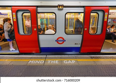 LONDON, ENGLAND -22 JUN 2017- Mind the Gap warning sign written in the London Underground (familiarly called the Tube), a public transit system serving 270 stations in greater London.