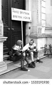 London, England - 23 March, 2019: Make Britain Breton Again sign and two men dressed up as knights, at People's Vote Demonstration on Brexit, London, UK, March 2019.