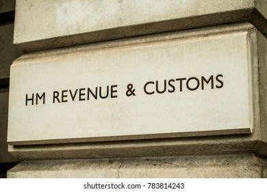 London, England. 23rd December 2017. EDITORIAL -Close up of HM REVENUE & CUSTOMS stone sign on the exterior of government building in Whitehall, London, England.